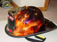 A hand painted helmet would make a great addition to the cave! Firefighter Bar, Firefighter Equipment, Volunteer Firefighter, Firefighter Tattoos, Firefighters Wife, Firemen, Fire Helmet, Fire Art, Custom Paint Jobs