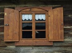 Wooden shutter and lace courtains