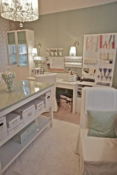 What a dreamy home office! I love the chandelier and pegboard for storing craft supplies!
