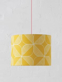 The best-selling Rosette drum lampshade takes its inspiration from a traditional Eastern Rosette pattern. Hand-drawn with the Sian Elin signature markings, it combines Eastern design with Scandinavian style. MADE FROM100% cotton, PVC lining FITTINGThis design works as either a pendant (ceiling) or lamp-stand shade MANUFACTURINGEvery single lampshade is hand-rolled with precision and care, paying close attention to the natural qualities of the fabric. Made in England. DELIVERYPlease note there ar