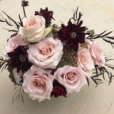 Flower arrangement in pedestal vase with quicksand roses, karma chocolate dahlias, chocolate Queen Anne's lace, and willow myrtle after dark. Florals. Wedding. Centerpieces. Rose. Blush. Burgundy.
