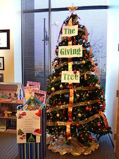 arvadas theme this year is the giving tree featuring a toy drive winter wonderland christmas tree decorations - Christmas Tree Toy Decorations