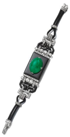 An Art Deco jadeite, onyx, enamel and diamond bracelet, 1930s. The centre composed of a polished onyx plaque set with a cabochon jadeite between millegrain-set single- and circular-cut diamonds, black enamel, single-cut and rose diamond links, on a black rope strap, signed Cartier, French assay and maker's marks. #ArtDeco #bracelet