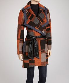 For the lady who refuses to blend into the blacks, browns and grays of typical winter coats. This can't-miss geo-pattern option is infused with wool to keep out the cool and a classic trench silhouette that won't give in to even the toughest wind.Measurements (size S): 34'' long from high point of shoulder to hem80% polyester / 20% wool