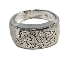 Mens Sterling Silver Ring • Vintage Etched Dragon Silver Ring • Chinese This silver mens ring features the image of a traditional, Chinese-style dragon etched into the top. Im no metallurgist, but this polished up nicely with sterling silver cleaner, BUT it has a chip at the underside of the band that shows definitely-not-silver metal, so Im guessing its silver-plated. Either way, its a very cool ring. If this ring doesn't do it for ya, check out my shop for more great mens rings & clot...