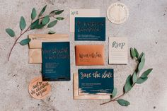 The on trend fall wedding invitation for this year! Luscious emerald paper with copper hot foil stamped, with a matching copper RSVP envelope. To ground the invitation, we mixed in a natural element with wood veneer envelopes and letterpress coasters | Photo by Alex C. Tenser Photography on The Wedding Crashers Tour.