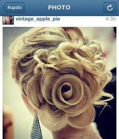http://www.modernsalon.com/hair-photos/how-to/hair-styling-updos/Rose-Inspired-Updo-from-MODERNs-Facebook-The-How-To-142827845.html