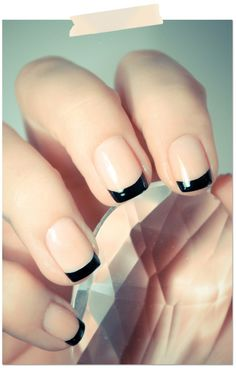 Black French manicure. I tried doing this (with navy blue) and was told by an older woman of a certain age that they looked 'like they're dirty'! Not sure I liked it either - mine didn't look as fabulous as these...