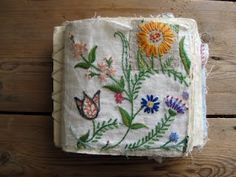 sample stitch book made from old domestic pieces of hand embroidery - Mandy Pattulo