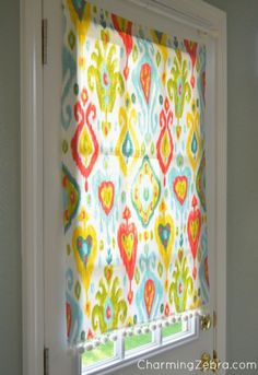 Back door...This no-sew project helps this blogger block the sun from blinding her family at dinner. A pretty square of fabric stays in place with magnets, and is super-quick to remove when she wants natural light to pour in again. Get the tutorial at Charming Zebra »