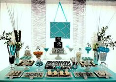 non traditional teal and black dessert table for a baby shower