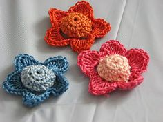 I used a sz C hook for this and while it came out just as well as the picture shows, I don't have the patience to repeat this pattern over and over again.   http://donnascrochetdesigns.com/printerfriendlyone/flower-applique-free-crochet-pattern.html