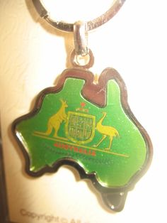 Australian Souvenir Key Ring - Australian Coat of Arms. The Coat of Arms of Australia is the official symbol of Australia. Designed in Australia. Manufactured with high quality materials and workmanship. Design: Australian Coat of Arms. Shape: Map of Australia. Color: Green, Gold, Silver. $39.99