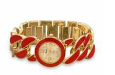 Woman's gold tone with red epoxy link accent fashion watch 45.00 USD