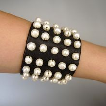 Leather cuff and pearls bracelet haute couture fashion handcraft jewelry design.