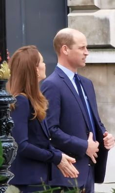 Neither of the Cambridges wore a face mask for their encounter with Ms Garraway, whose hus...