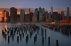 This New York City skyline photography image of the Big Apple skyline shows the Freedom Tower and surrounding FIDI skyscrapers. The image was photographed on a beautiful winter evening minutes before sunset.   Good light and happy photo making!  My best,  Juergen www.RothGalleries.com @NatureFineArt https://www.facebook.com/naturefineart