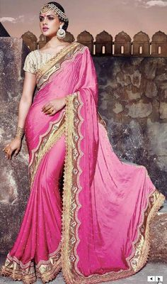 This designer sari, satin fabric in beige color embroidered is a prized addition to your exclusive saree collection. The fantastic sari creates a dramatic canvas with superb lace, stones and resham work. #pinksatinsaris #satinsareeonline #exclusivedesignersarees