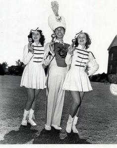 Drum Major Jimmie Baker poses with two majorettes at Oklahoma A&M (OSU) in Stillwater, 1940. Photo courtesy of OK Historical Society - TravelOK.com.