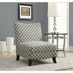 Add a unique #piece to your space with this accent chair featuring a straight plush back, generously cushioned and spacious seating and slightly tapered legs fin...