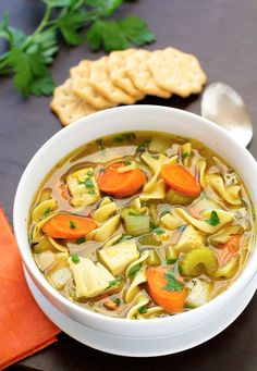 Slow cooker chicken noodle soup recipe that's as easy as tossing everything in the crock pot. Made with boneless chicken, egg noodles, carrots, and celery.