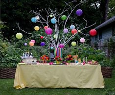 Michael Devine: For a summer drinks party, Michael fashioned a festive table with a centerpiece of colorful lit lanterns, cleverly fitted with LED battery votives.