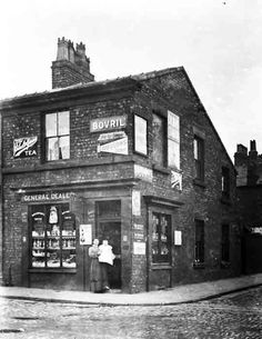 The grocery shop of Mrs Mary Slade, on the corner of Drysdale Road and Wilson Street. The Dingle (district of Liverpool, UK) sometime around the end of the 19th century maybe 1880-1900