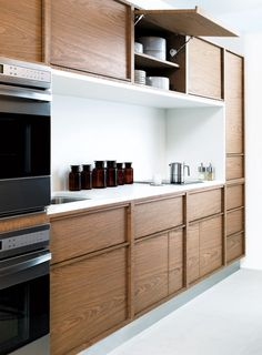 butler pantry ideas- lined space, garage doors, HInged Upper Cabinets | Remodelista
