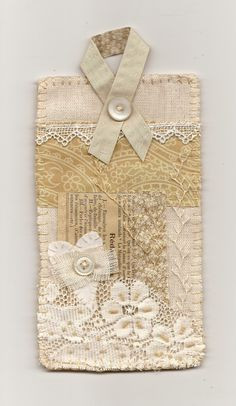 "Fabric Collage 3 1/2"" x 6 1/2"", hand-stitched, beaded, embroidered, lace, paper, fabric & felt. Felt backing stitched by hand with buttonh..."