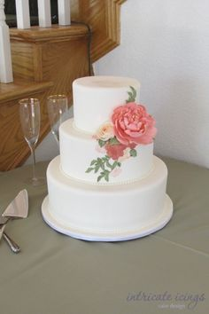 Love this cake the best!  Simple yet very elegant.  A cake topper would look cute on it too.