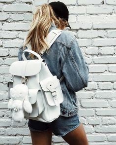 innochii | denim jacket, denim shorts, white backpack, black baseball cap