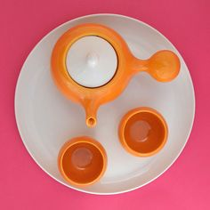 Orange bulb tea set: Asian-style side-handle teapot and 2 teacups.