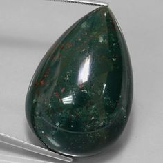 Bloodstone, also known as heliotrope, is a green gemstone dotted with bright red spots of iron oxide. A form of chalcedony quartz, the name heliotrope comes from the fact that polished stones were once thought to reflect the sun. Bloodstone is the original birthstone for March. In the Middle Ages the red spots were thought to be the blood of Jesus and the stone was believed to have miraculous powers. It draws it $ to me