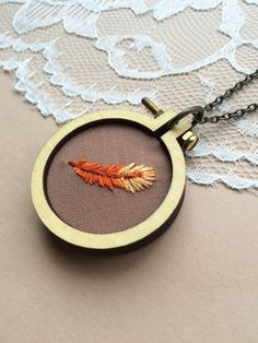 Feather Mini Embroidery Hoop Necklace: Hand Embroidered Rust Colored Feather by PlaidLoveThreads on Etsy