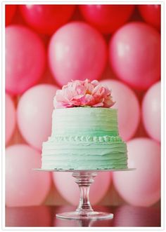 mint green frosted cake and pink peony