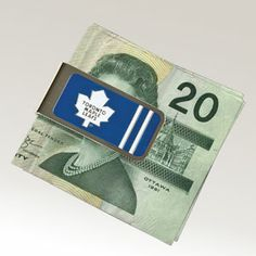 """Product # AP56505 - A money clip is the easiest way to carry bills, cards and receipts - without the bulk of a wallet! This metal clip is stylishly designed in his favourite team colours, with logo and engraved team name. 2""""L x 1""""W  $9.98"""