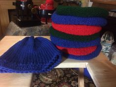 I came up with a hat pattern for addi king , after buying the machine having no patterns, looking at utube,  Cast on, knit 40 rounds, wrap yarn 1/2 around machine, cast off using red needle. Drawn crown tight. Sew twice one direction, twice the other, knot inside hat. Crochet 4 to 6 rounds for brim Makes a good blank hat Emblish with crochet flowers for Pom poms or reg poms or non, add flowers along sides. Here is one with brim and a stack waiting for brims Addi Knitting Machine, Circular Knitting Machine, Knitting Machine Patterns, Knitting Needles, Knitting Socks, Knitted Hats, Knitting Ideas, Addi Express, Cast Off