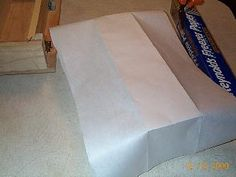 lining a soap mold by creating an cardboard insert and then wrapping with parchment paper. Remove from cardboard and place in mold.  Looks easier working from the outside than the inside.
