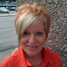 Strawberry Blonde Pixie With Long Bangs