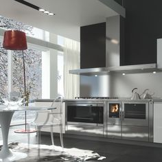 The cooking stove by Pertinger: the perfect combination between high quality, astonishing functionality, modern Design and environmental friendliness. Wood Stove Cooking, Kitchen Stove, Extractor Hood, Home Furnishings, Modern Design, Table, Furniture, Home Decor, Houses
