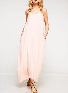 """Our best selling maxi now in a gorgeous demure pale pink! Adjustable straps and with POCKETS! Lined and just the right length for us shorter gals!  100% Rayon/Lining 100% Rayon  Model height is 5'4"""""""
