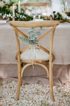Crossback chair with eucalyptus details: http://www.stylemepretty.com/2015/07/09/romantic-la-vie-en-rose-wedding-inspiration-in-provence/ | Photography: Tamara Gruner - http://www.tamaragruner.com/