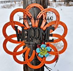 horseshoe welcome wreath Horseshoe Wreath, Welcome Wreath, Metal Flowers, Welding Projects, Flower Fashion, Pick One, How To Better Yourself, Diy And Crafts, Symbols