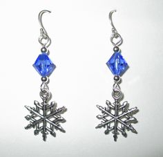"Lovely whimsical pair of pewter Snowflake earrings on sterling silver hand-craft earwires with silver-plate beads and findings and Swarovski crystal. A pair of delicate ""Snowflake Bay"" earrings perfect for your winter wardrobe!  Approximate length 1 1/2"" inches."