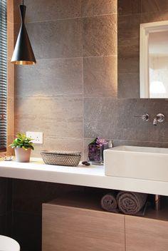 Wall tiles...run up wall behind lav in master bath...floating mirror.
