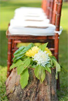 Simple stump wedding aisle decor with florals. Event Design: Michelle Garibay ---> http://www.weddingchicks.com/2014/06/09/ohana-wedding-in-honolulu/