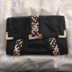 Beautiful 100% Authentic L.A.M.B. Clutch Beautiful 100% authentic used leather & woven L.A.M.B. Clutch comes with original dust bag. Purchased from Neimans outlet store. Lots of space inside & zipper in the back to hold more necessities.  Hardware shows some scratches from use. L.A.M.B. Bags Clutches & Wristlets