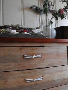 Our friend Tricia Rose (creator of Rough Linen) has a nautical theme going on in her home: To spruce up some drawers, she threaded rope through four drilled holes.