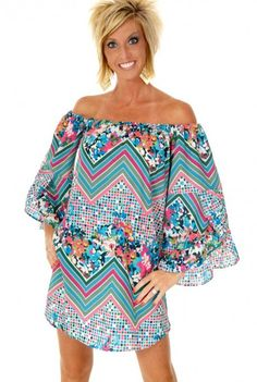 This Karlie Bahama Mama Dress is a fun little off the shoulder dress that is super summery in every way.  The oversized sleeves give an airy feel.  The amazing print of floral, chevron, and squares come together to create a very unique look.  While this dress is shown as an off the shoulder dress, you also wear it on the shoulders as well.  Oh so stylish and on so summer!