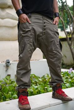 This Drop Crotch pants, Drop Crotch Harem Pants, Low Crotch Pants, Drop Crotch Men, Drop Crotch Women, Handmade pants, Cotton Canvas, Green,Beige is just one of the custom, handmade pieces you'll find in our pants shops. Indian Men Fashion, Mens Fashion, Drop Crotch Pants Men, Tactical Clothing, Cyberpunk Fashion, Cargo Pants, Harem Pants Men, Mode Style, Mens Clothing Styles